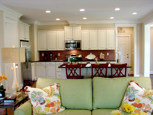 A cream and red kitchen with matching living room.