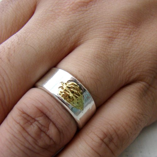 Unique wedding band with leaf imprint.